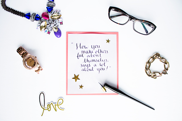 "Light and bright photo of a styled, modern pointed pen calligraphy quote - ""How you make others feel about themselves says a lot about you"""