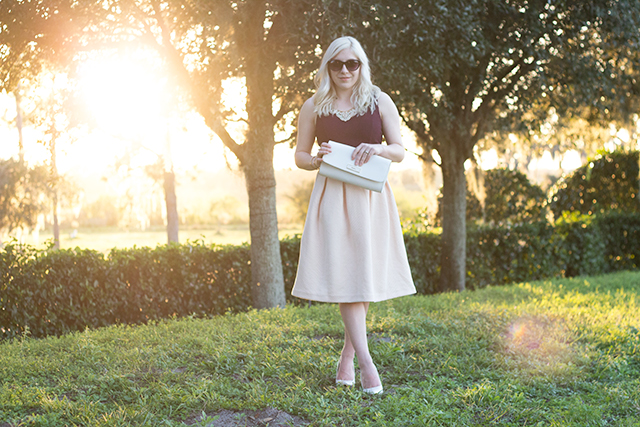 Manitoba fashion blogger wearing a blush midi skirt and white accessories.