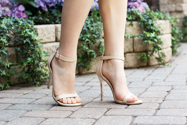 Strappy nude stilettos.