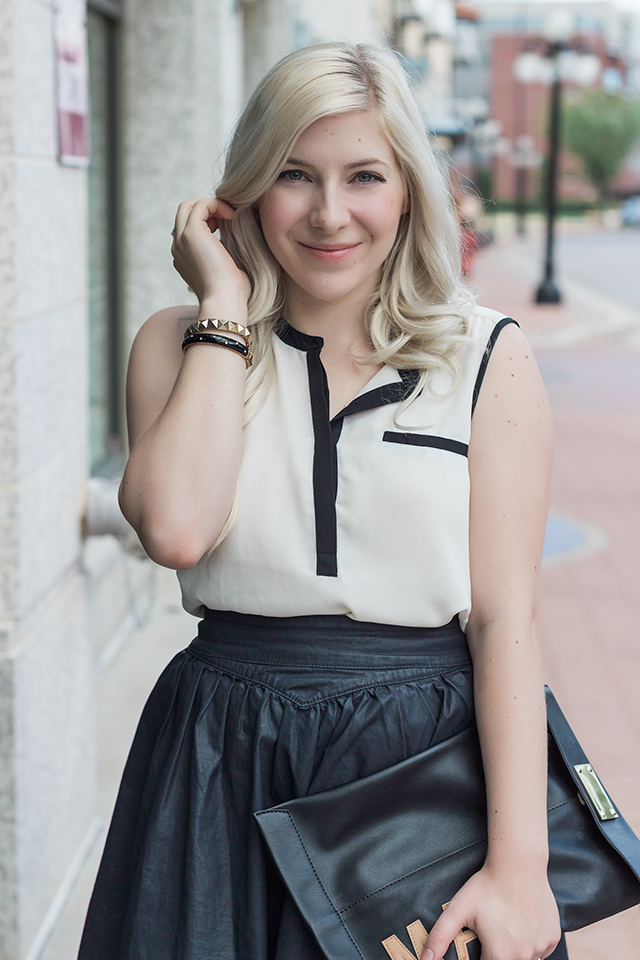 Black and white contrast trim sleeveless blouse.