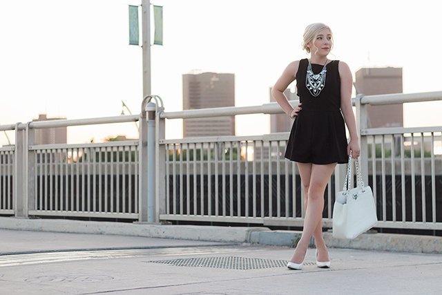 Black romper with white accessories.
