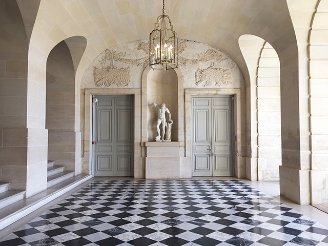 Black and White marble flooring inside the Palace of Versailles.
