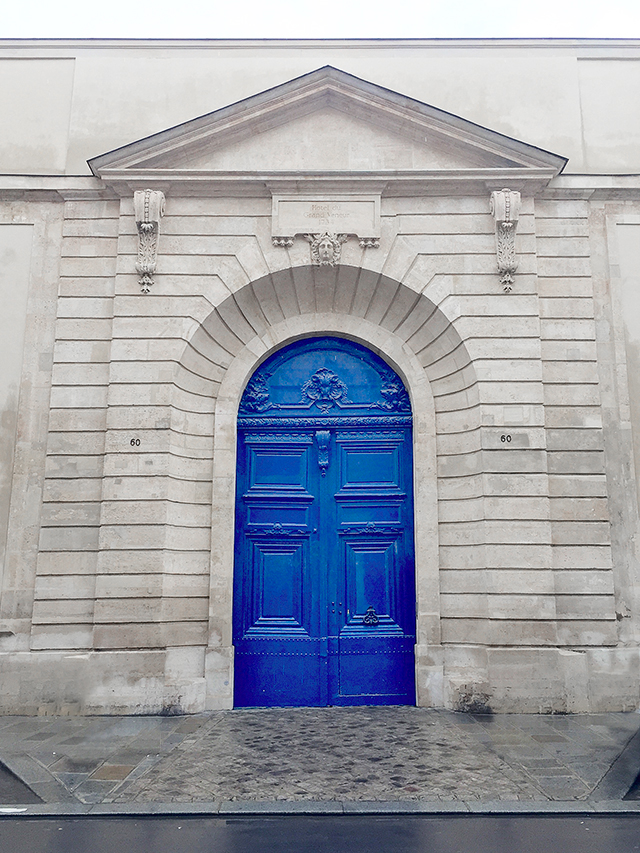 Stunning ornate blue door in Paris, France