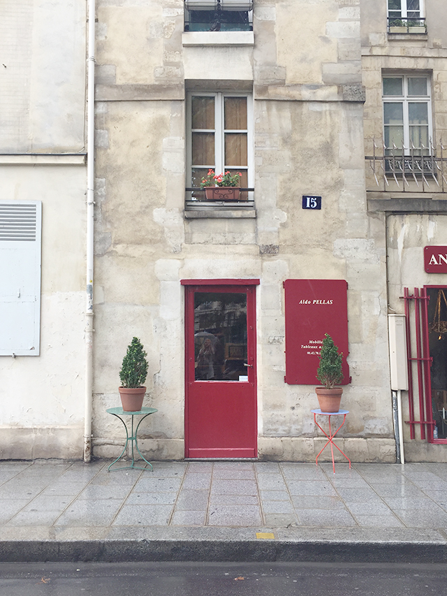Charming little Parisian shop with red door.
