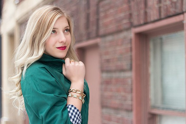 Winter Outfit Inspiration // Emerald green trench coat with a plaid button down and modern gold accessories,