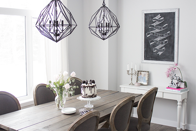 logger home tour: Inside a bright modern Parisian dining room with a diy farmhouse table