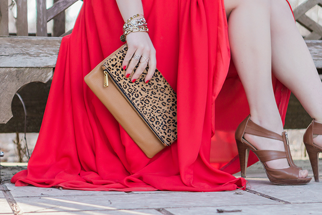 Red chiffon maxi dress with leopard print and gold accessories.