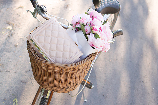 Vintage bike with pink flowers & straw basket.