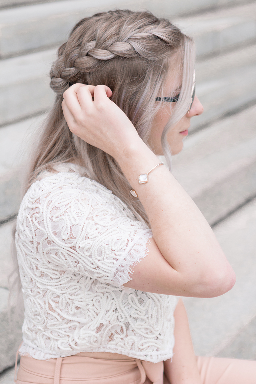 Pretty braided half-up hairdo.