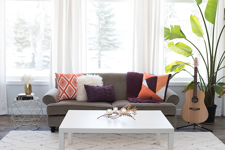 Spring home decor trends: Bold burgundy and orange living room.