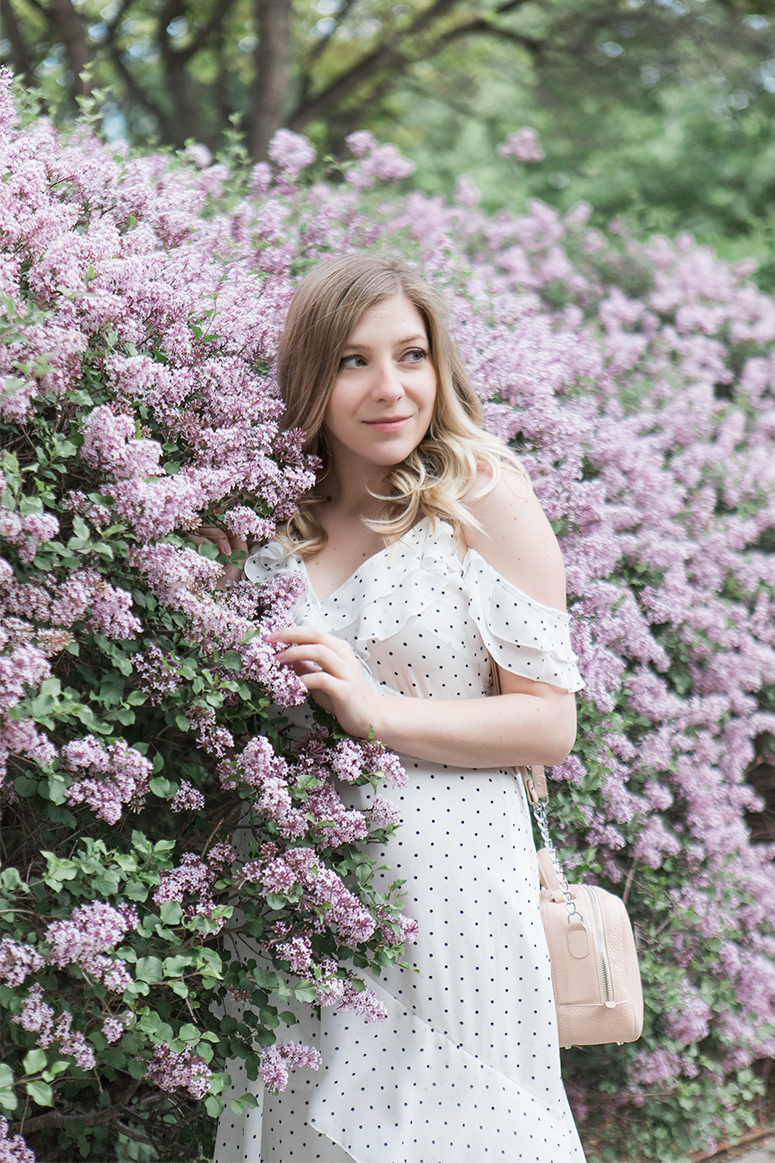 White polka dot ruffle dress with blush pink accessories. Outfit inspiration from Canadian fashion blogger Jennifer Ashley.