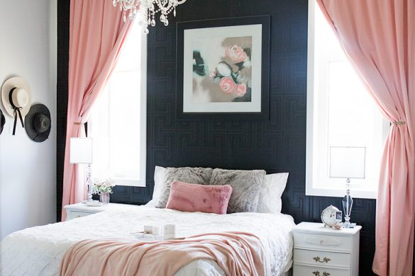 A cozy and glamorous white, black and blush pink bedroom.