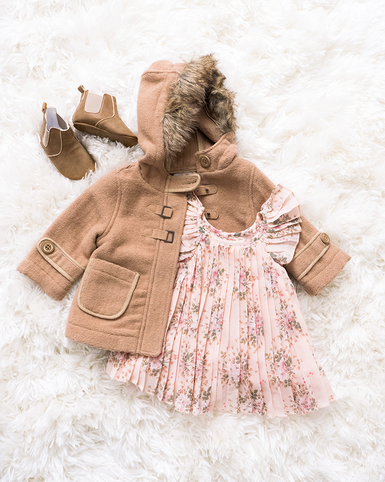 Baby girl clothes flatlay. Cute hipster baby clothing.