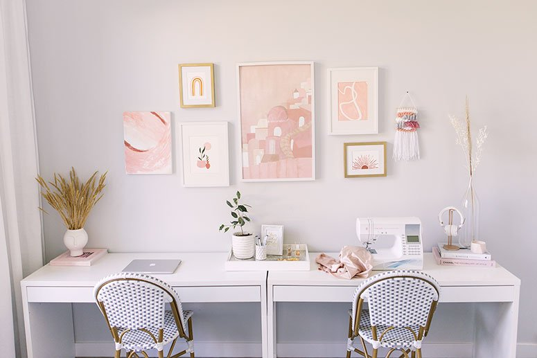 White double Ikea desks in a modern feminine office.
